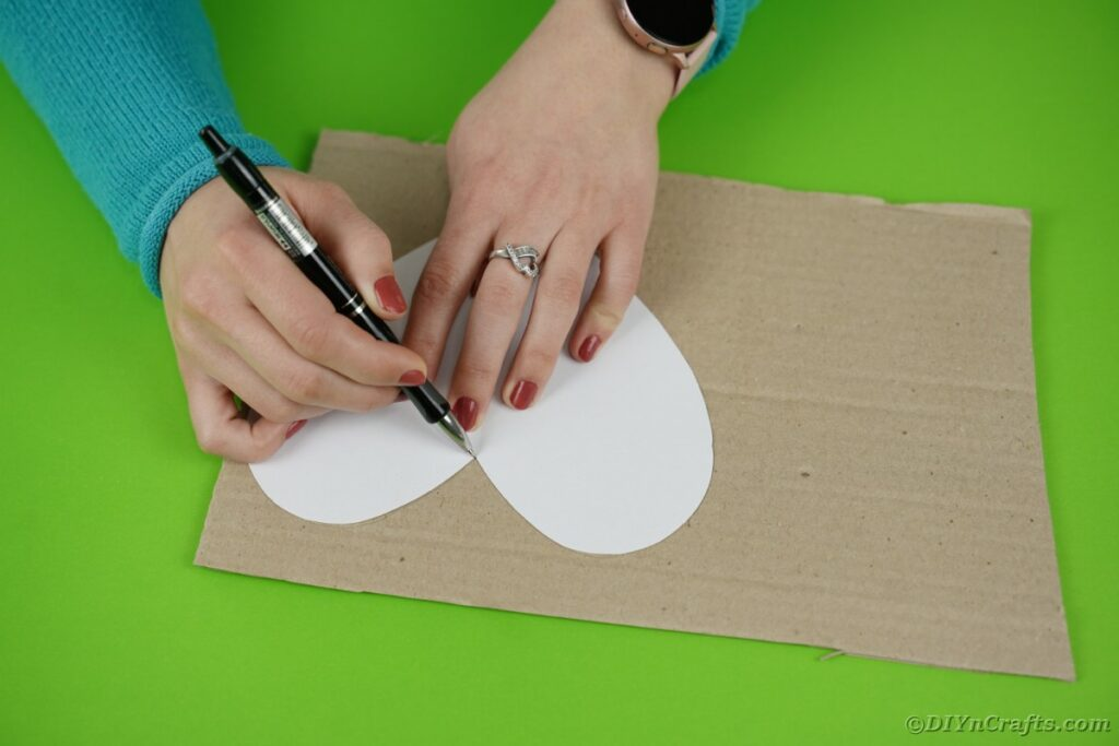 Tracing heart on cardboard