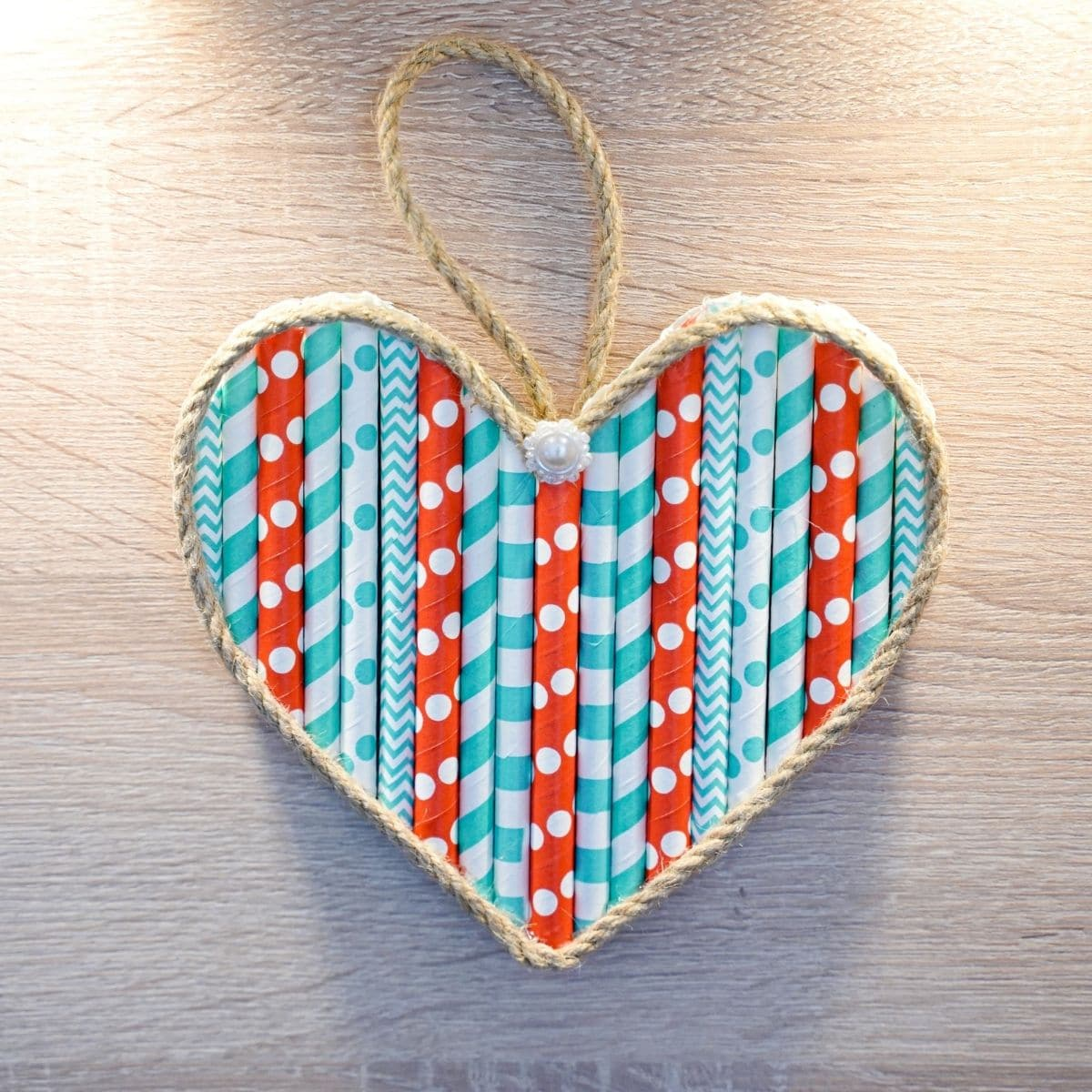 Paper straw heart on wall