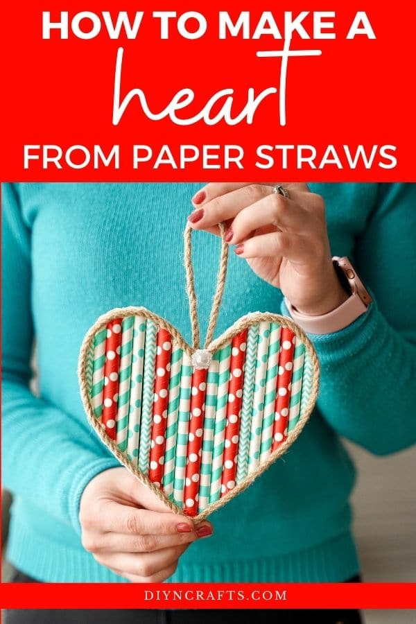 Woman holding paper straw heart