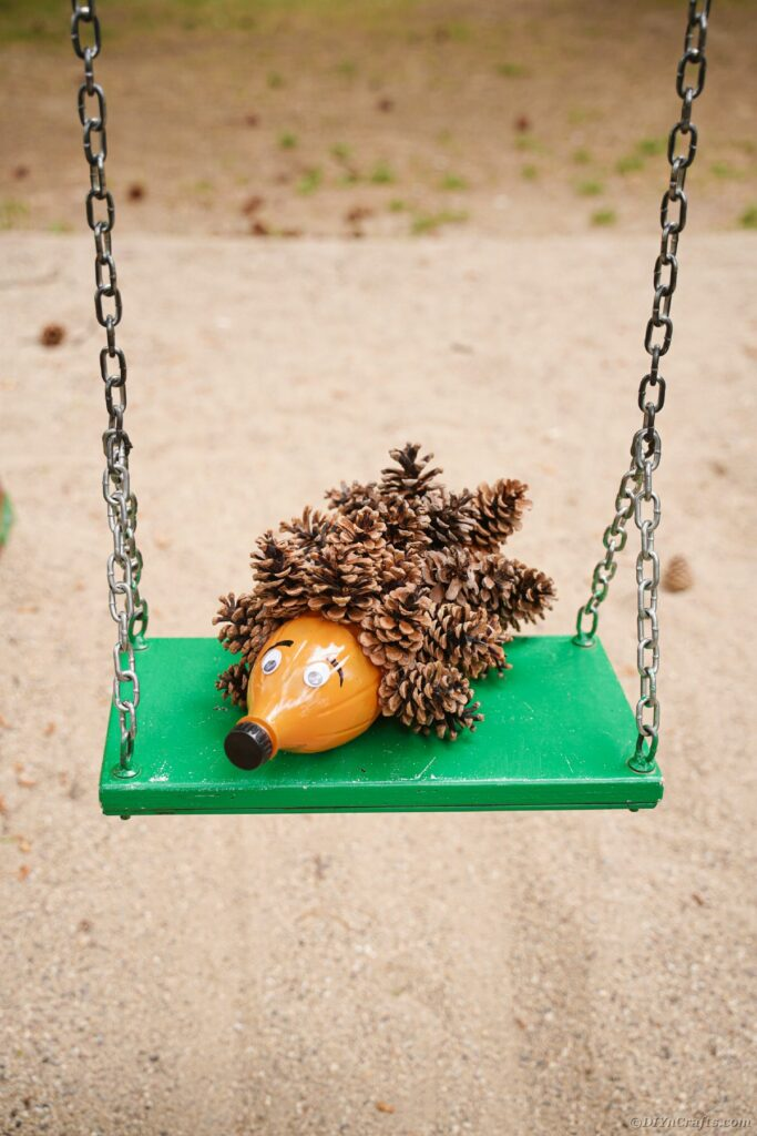 Hedgehog decoration on green swing