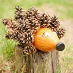Pinecone hedgehog on a stump