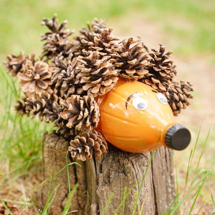 Pinecone hedgehog on a stump