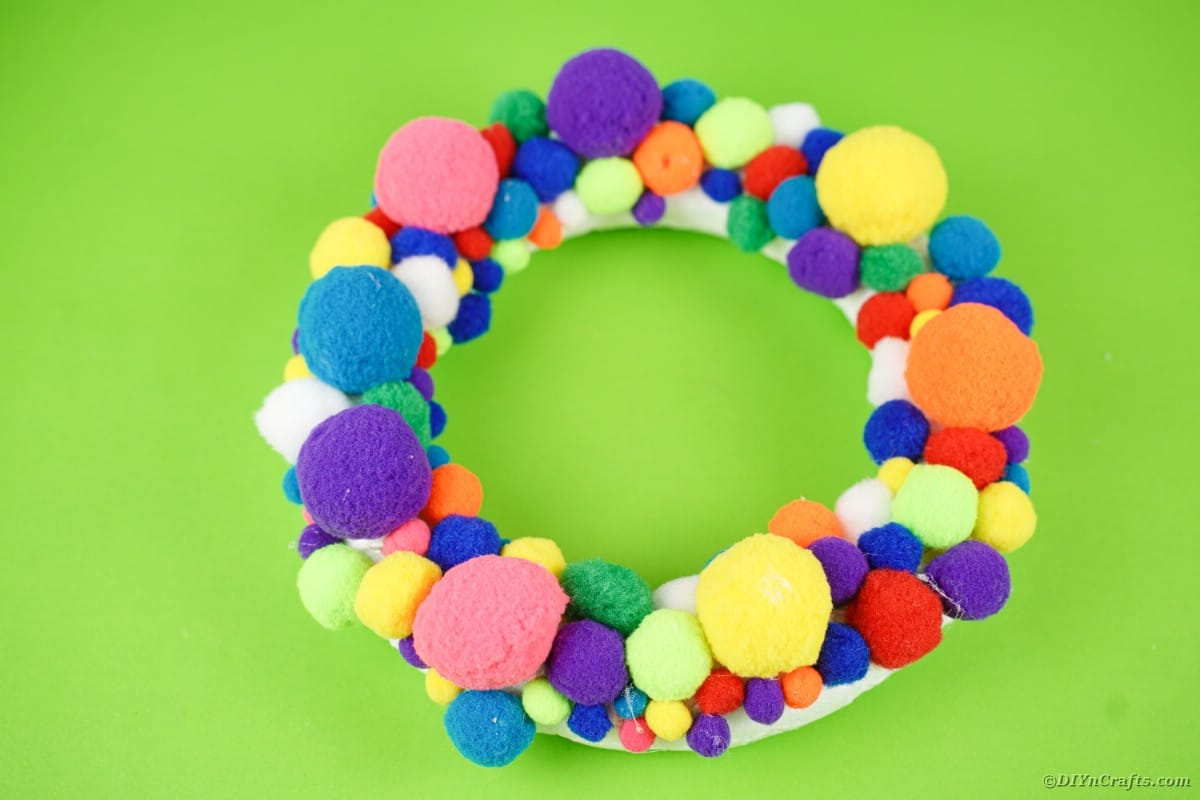 Wreath form covered in pom poms
