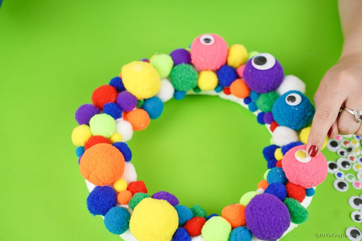 Gluing eyes to wreath