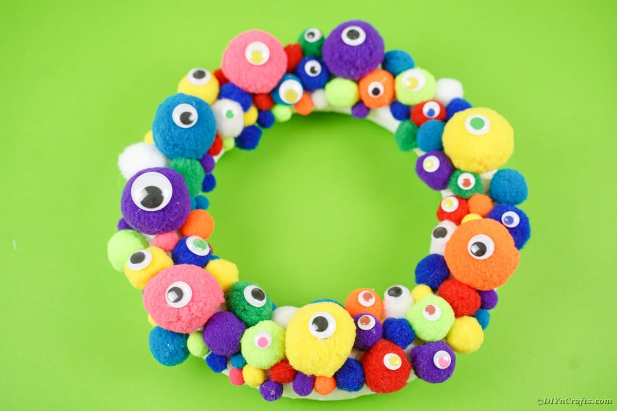 Monster wreath on green surface