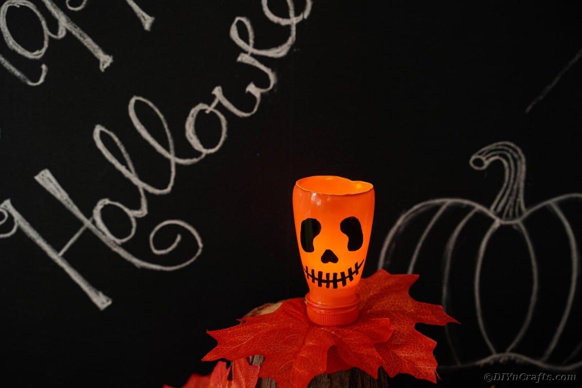 Pumpkin lantern by chalkboard