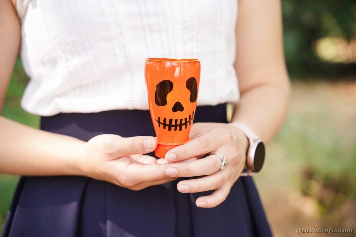 Woman holding a pumpkin lantern