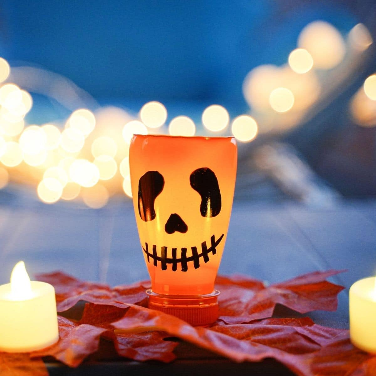 Pumpkin lantern on leaves with candles