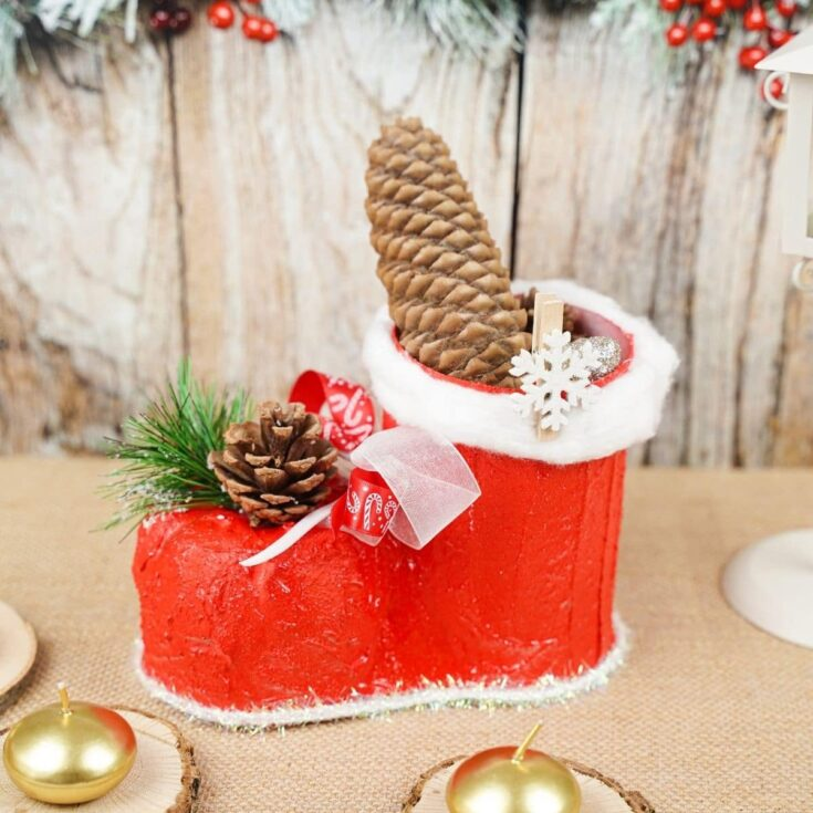 Santa boot on table by wooden board