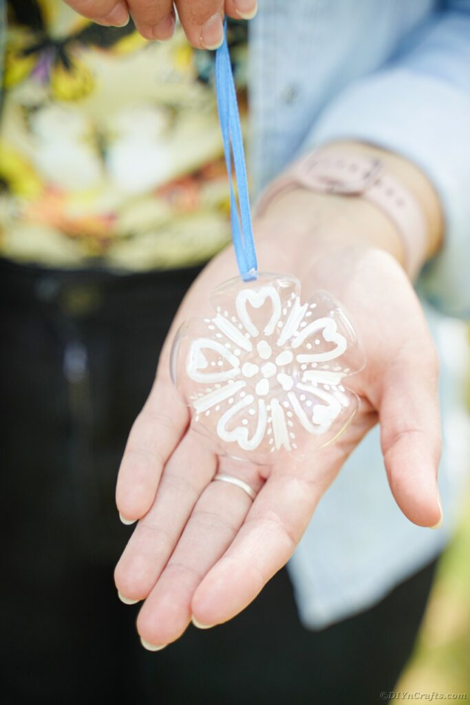 Snowflake ornament in hand