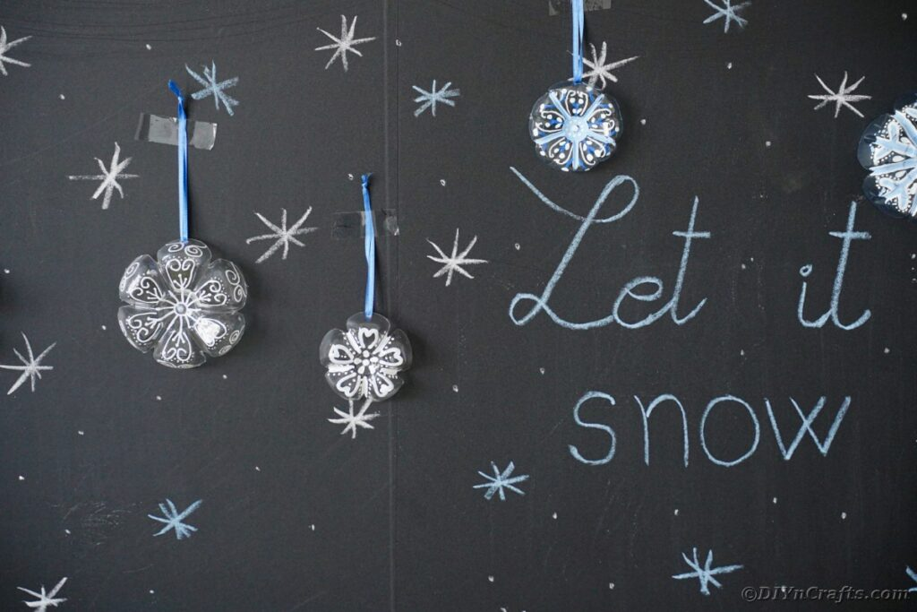 Snowflake ornaments on chalkboard