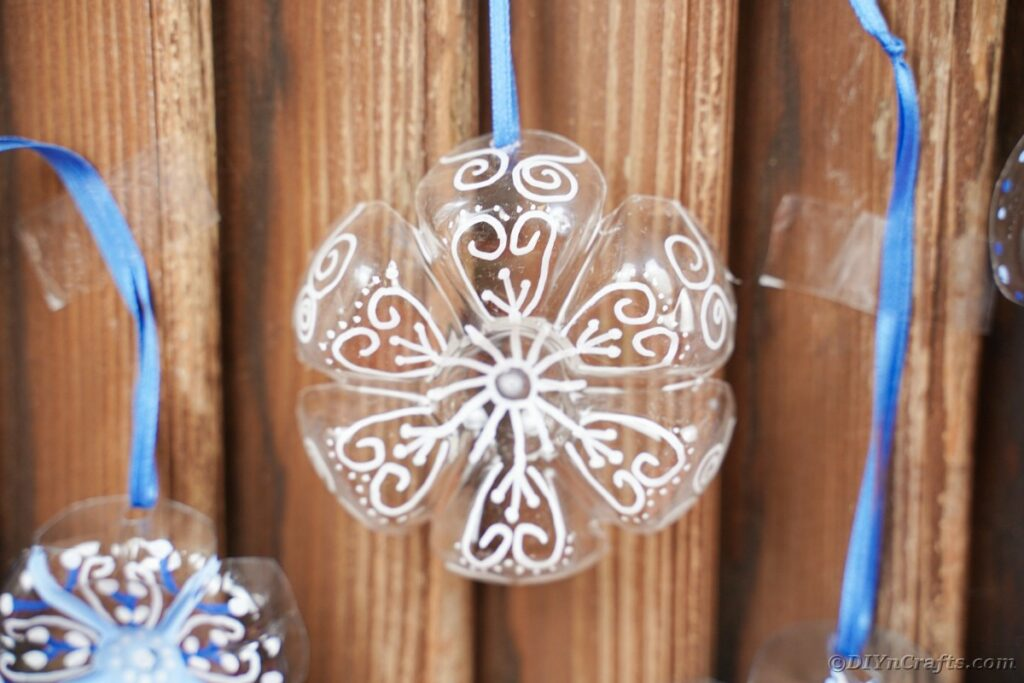 Snowflake ornaments on wooden wall