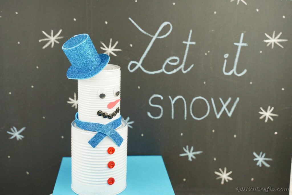 Tin can snowman by chalkboard