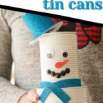 Woman holding tin can snowman