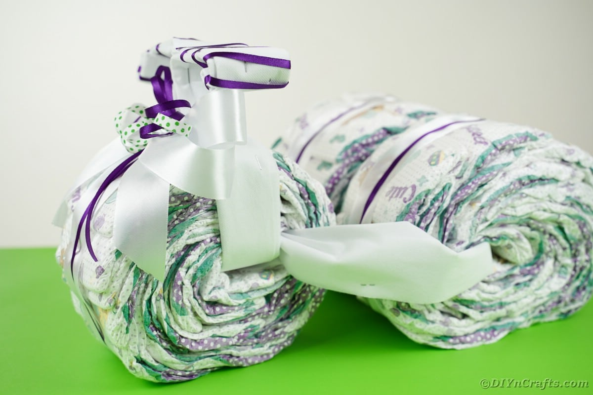 Tricycle diaper cake on green table
