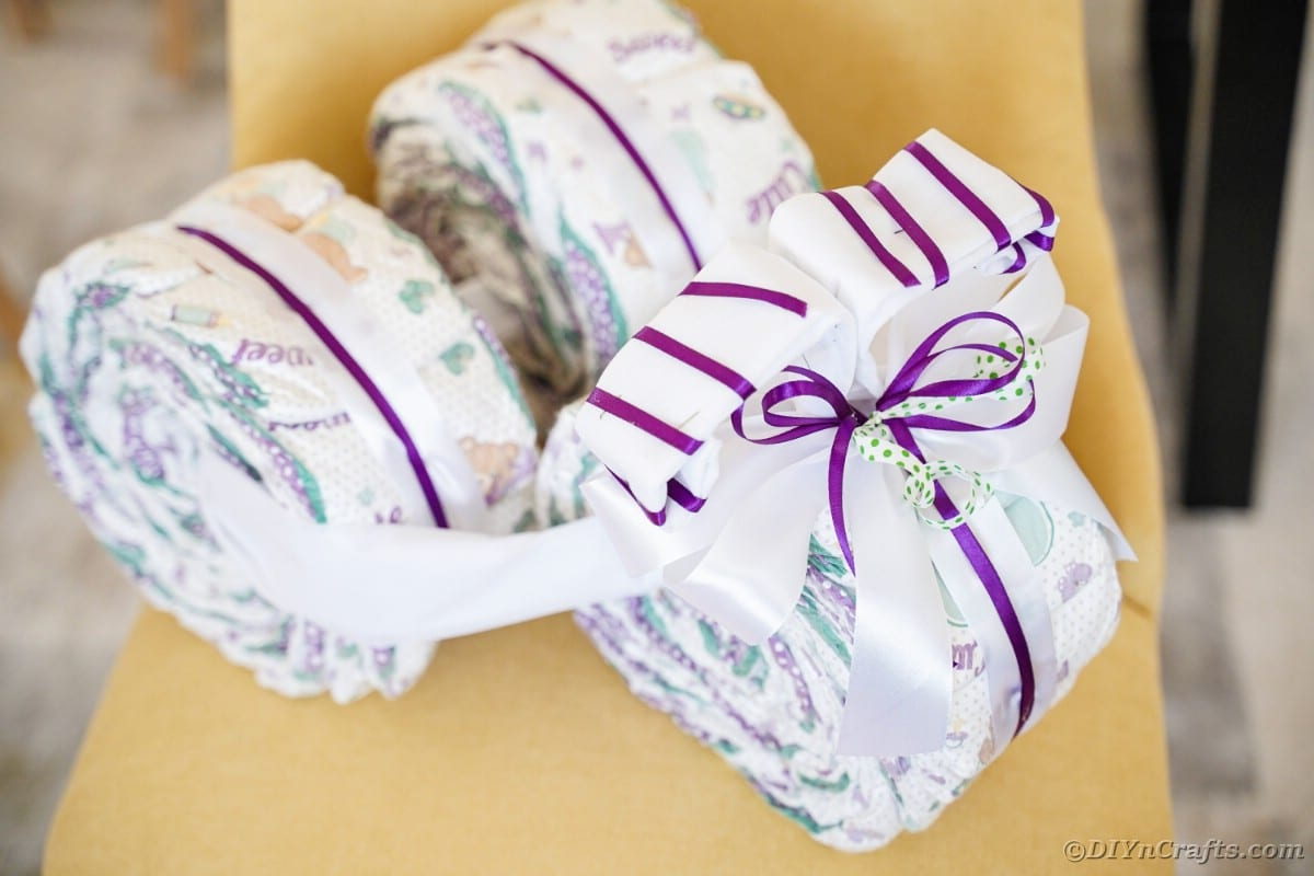 Tricycle diaper cake on chair