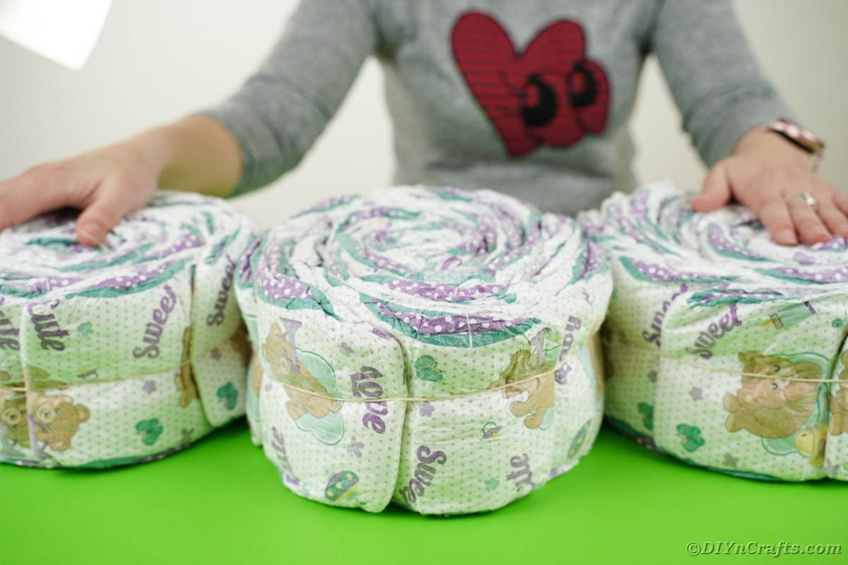 Three rolls of diapers