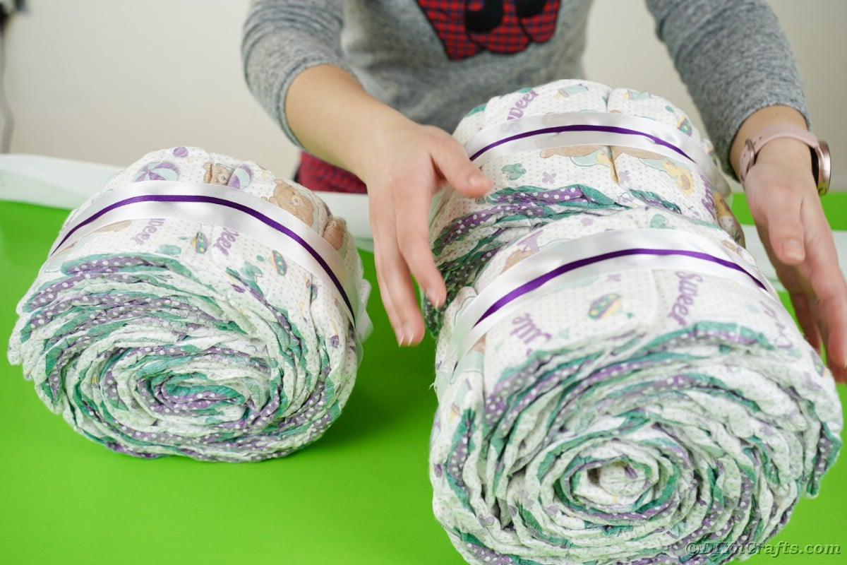 Stacking diaper rolls into form
