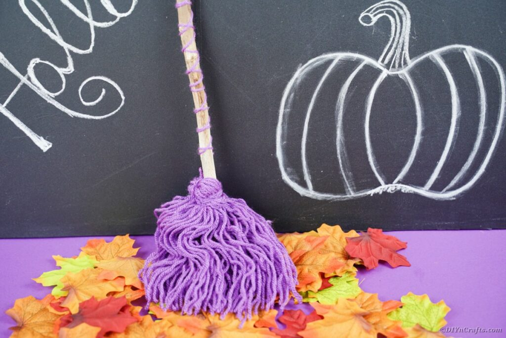 Witch's broom against chalkboard