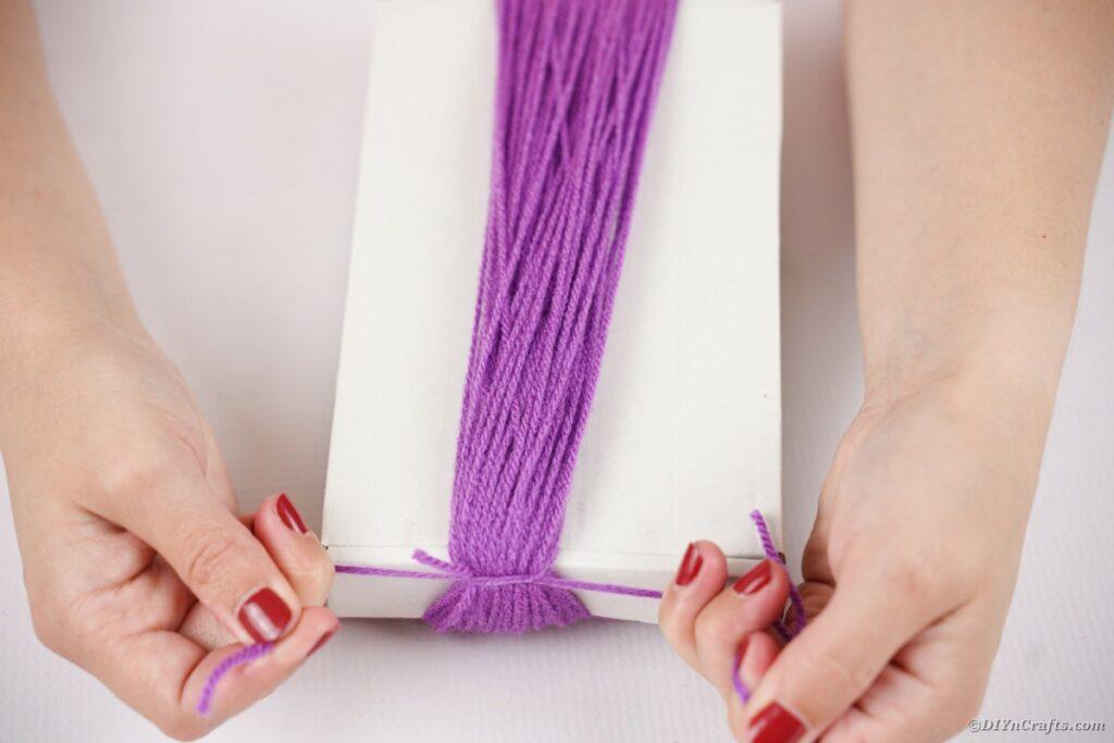 Purple yarn around box