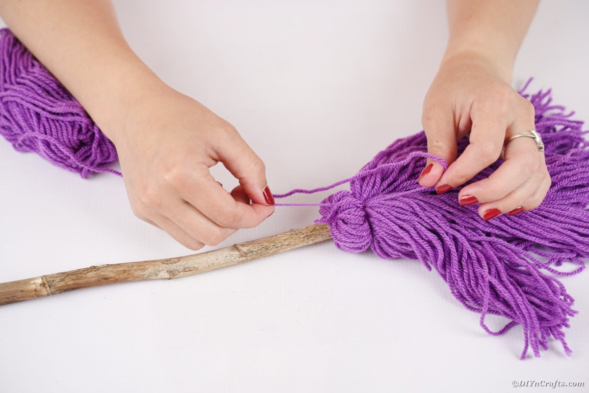 Attaching yarn to broom