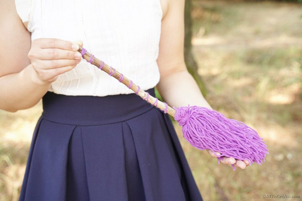 Woman holding witch's broom