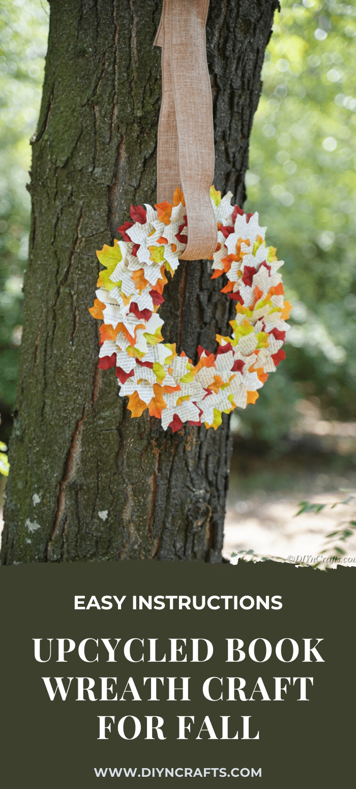 Autumn wreath made from leaves and recycled books hanging from a tree
