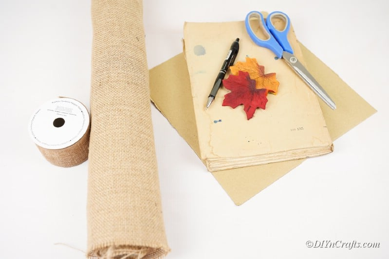 craft supplies old book burlap leaves