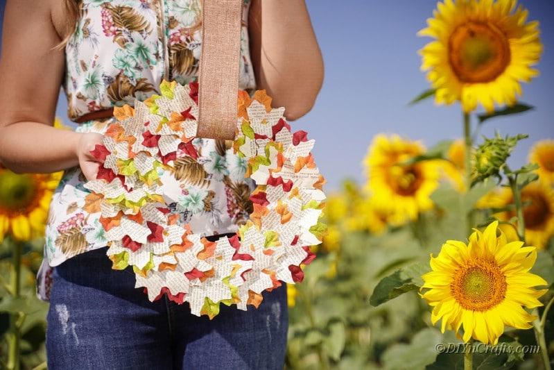 beautiful fall wreath woman holding in field