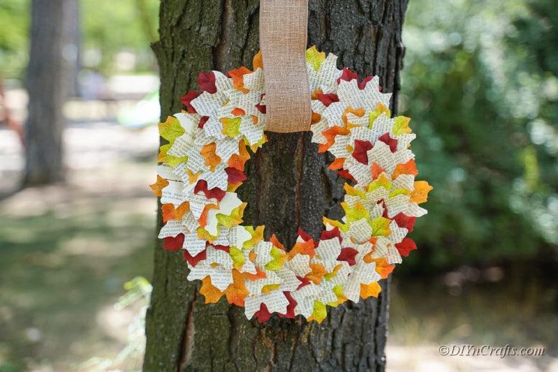 handmade wreath hanging on tree outdoors