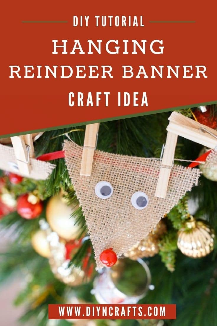Reindeer themed decorative banner on a Christmas tree