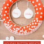 Red wreath bade from buttons on a wooden backdrop