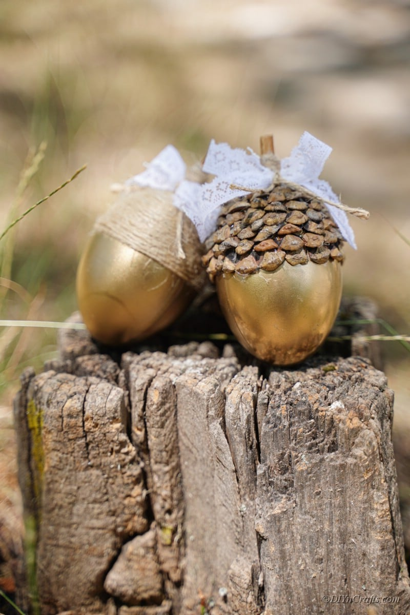 pair of decorative golden acorns crafted by hand