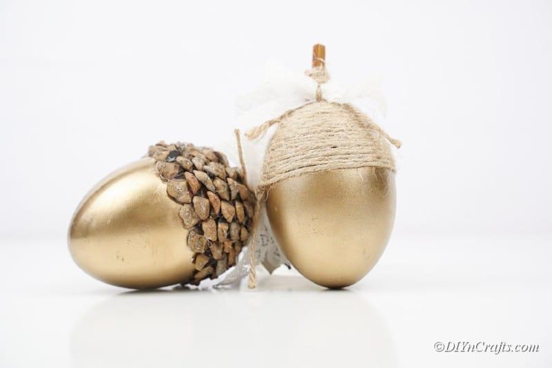 pair of gold craft acorns