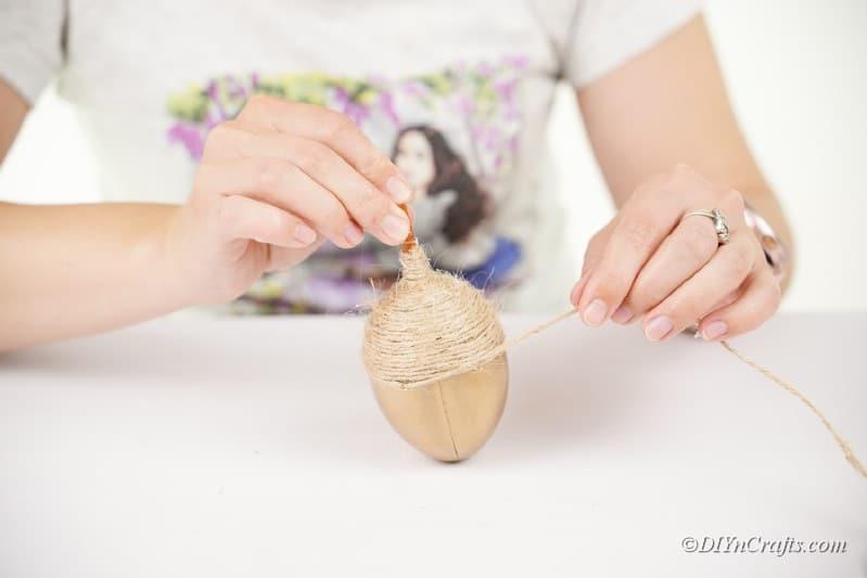 twirling twine around a craft
