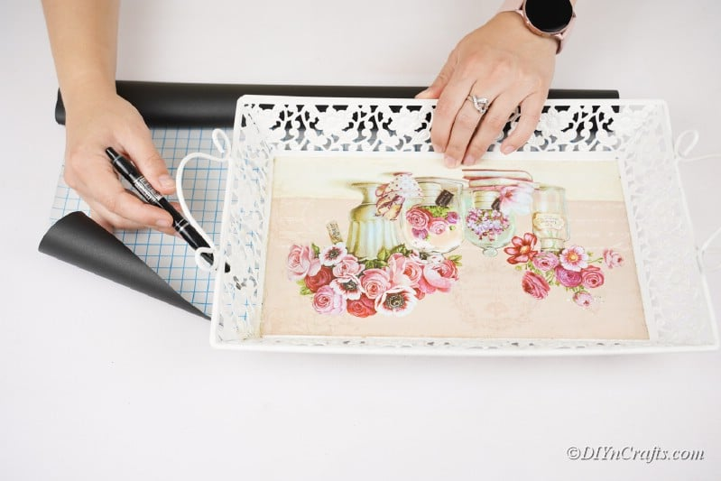 woman working with old tray on table