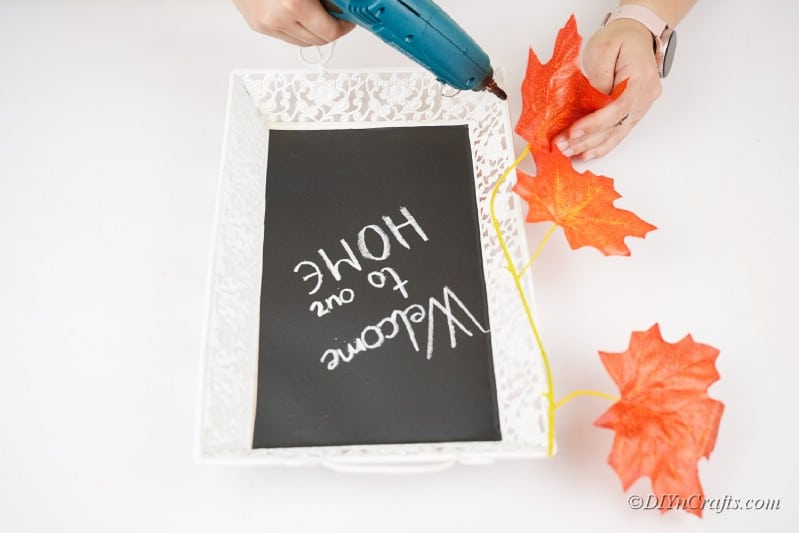 adding decorations to craft tray project