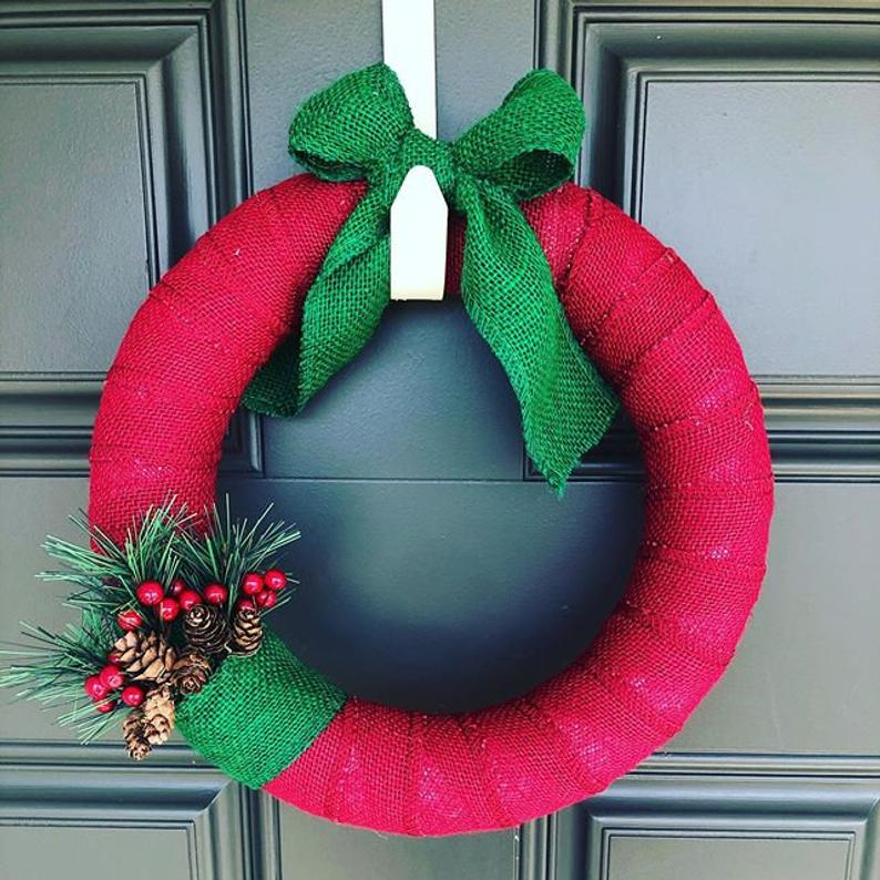 Holiday wreath wrapped in red and green burlap