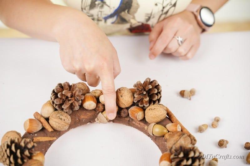 placing pieces onto a foam craft wreath