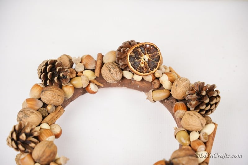 rustic wreath being decorated with small pieces