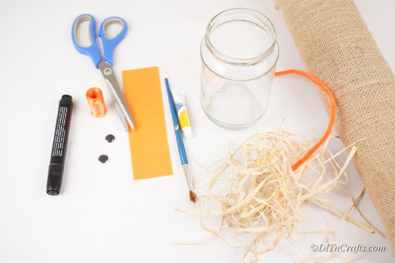 assortment of craft supplies on table