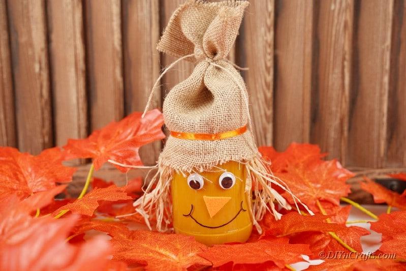 Scarecrow jar craft on decorative spread