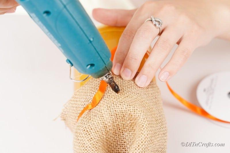 hot glue gun ribbon on burlap bag