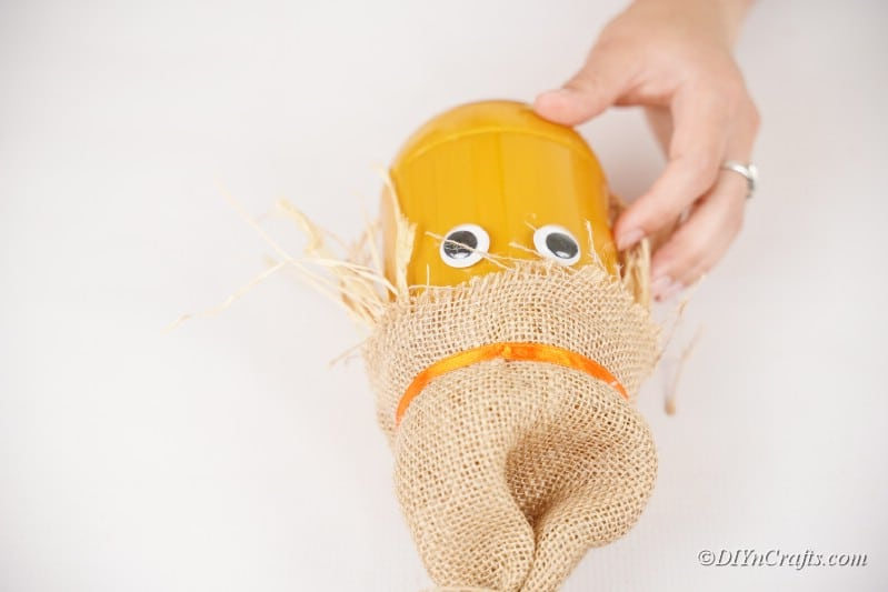 googly eyes on jar craft with straw and burlap hat craft