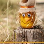 Scarecrow jar craft sitting on a stump