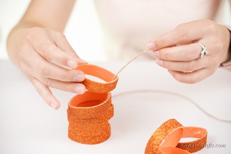 twine and toilet paper roll womans hand table