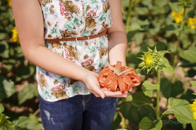 woman holding pumpkin crafts