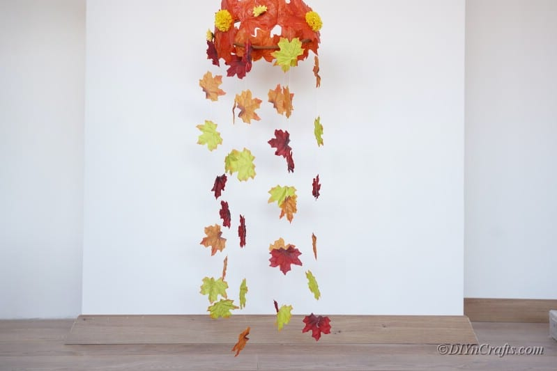 Fall leaf wind catcher hanging against white wall