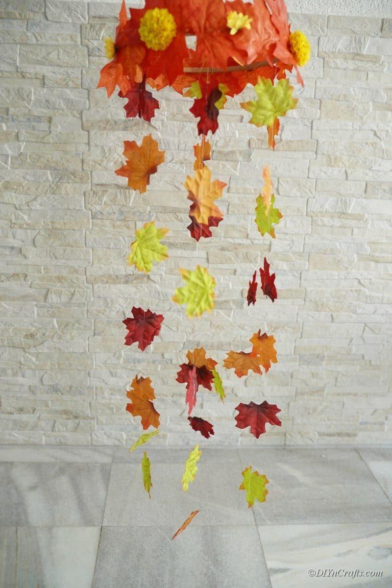 Brick wall behind fall leaf mobile