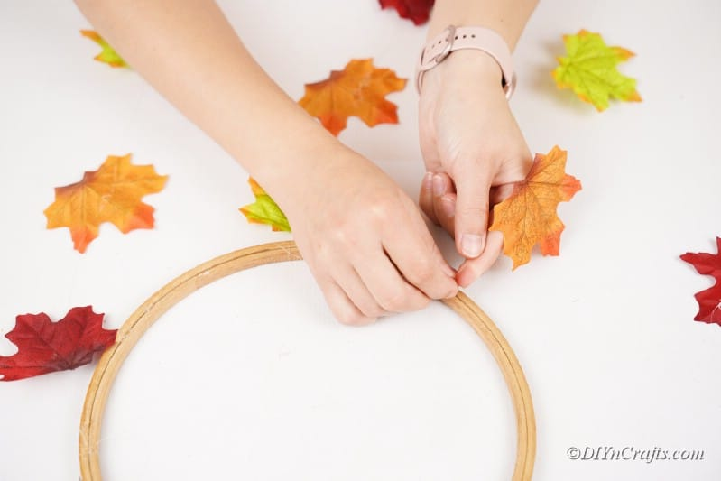 attatching strings to wooden craft hoop